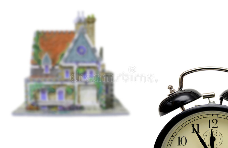 House with alarm-clock. Five to twelve isolated on white background stock images