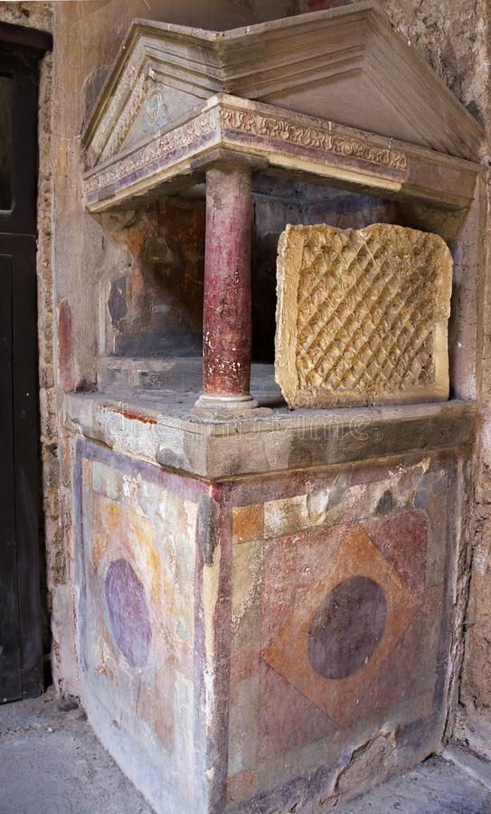 House altar - Pompeii-I- Italy. Pompeii was an ancient city in Campania on the Gulf of Naples, which like Herculaneum, Stabiae and Oplontis was buried during the royalty free stock image