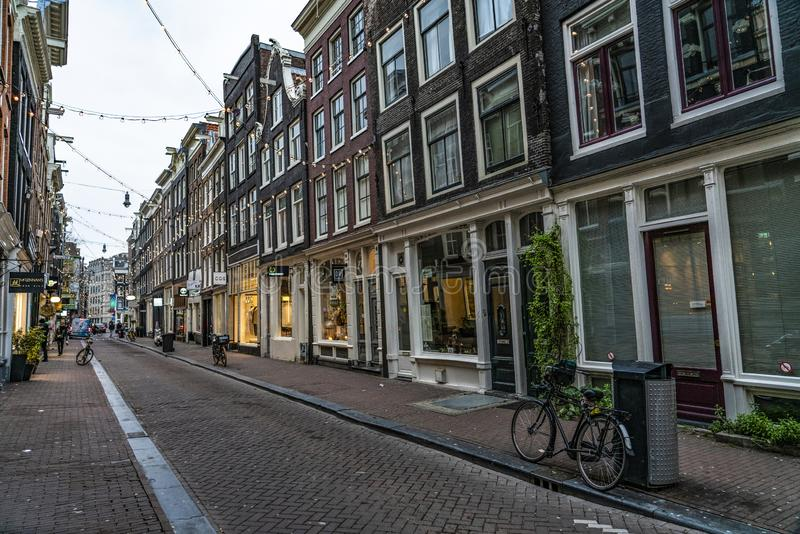 House of Amsterdam Holland. Amsterdam Holland The city of Amsterdam, capital of the Netherlands, is built on a network of artificial canals in Dutch: grachten royalty free stock image
