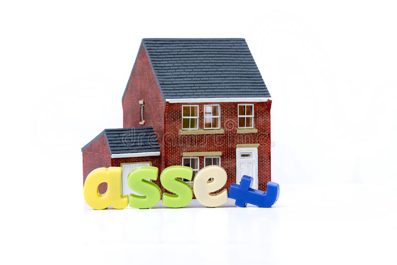 House is an asset concept with model house and letters. House is an asset concept with model house stock image