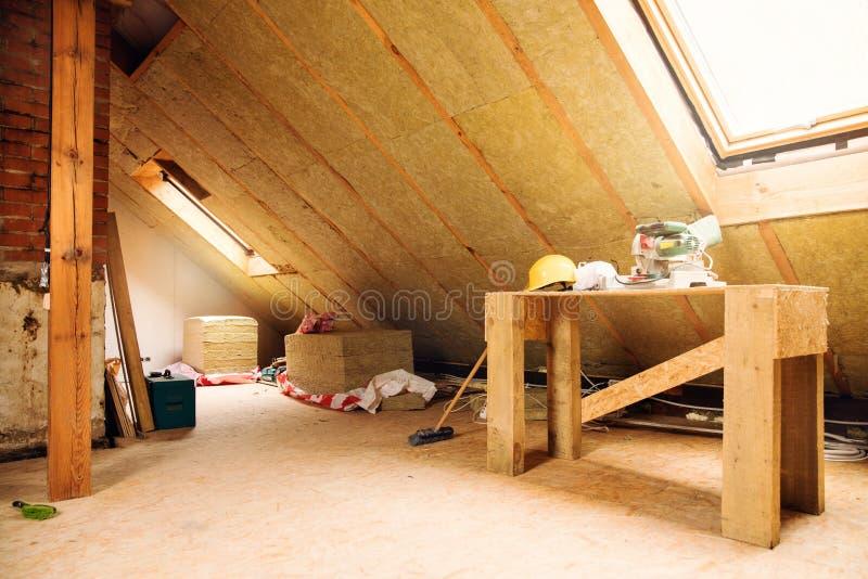 House attic under construction mansard wall insulation stock photography
