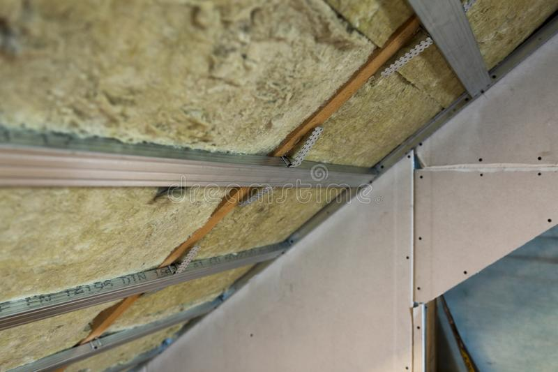 House attic under construction mansard wall insulation with rock royalty free stock photo