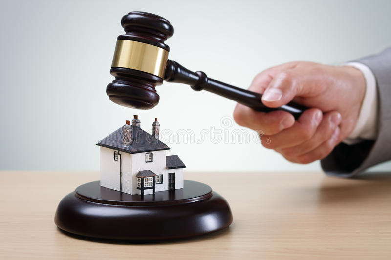 House auction. Bidding on a home, gavel and house concept for home ownership, buying, selling or foreclosure royalty free stock images