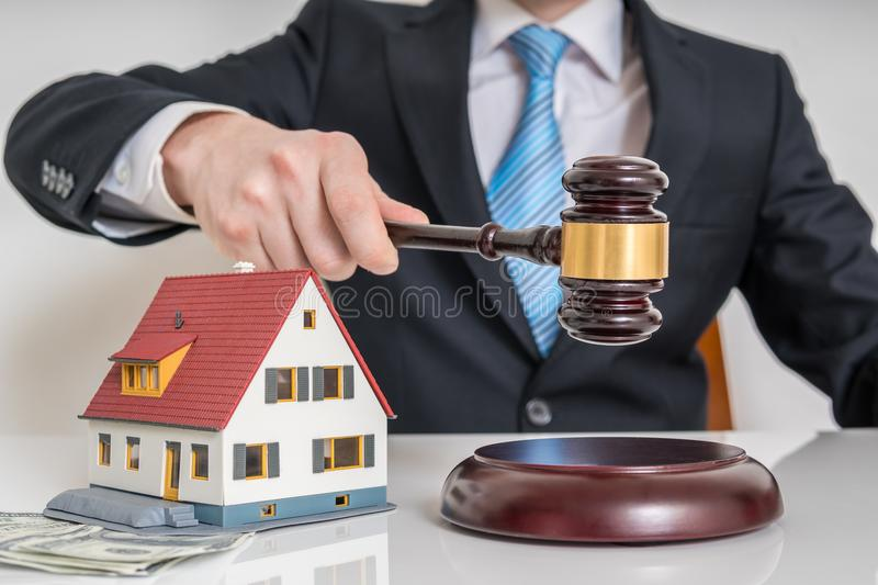 House auction concept. Auctioneer is knocking with gavel.  royalty free stock image