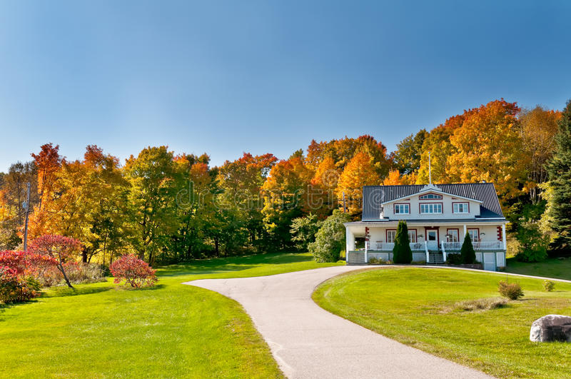 House and autumn forest stock photography