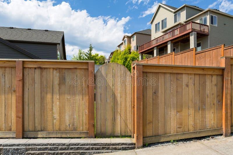 House Backyard Garden Wood Fence Gate. House backyard new wood fence garden gate door in suburban residential neighborhood stock photos