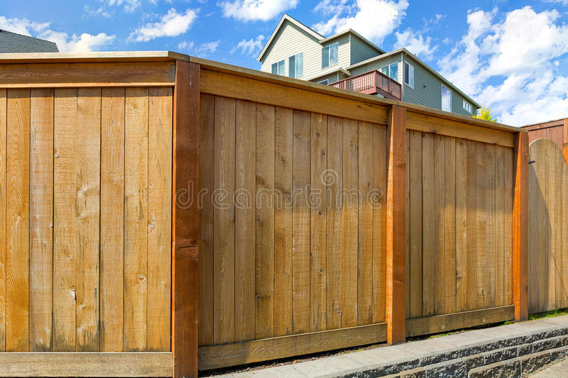 House Backyard Wood Fence with Gate. House backyard new wood fence with gate door in suburban residential neighborhood royalty free stock images
