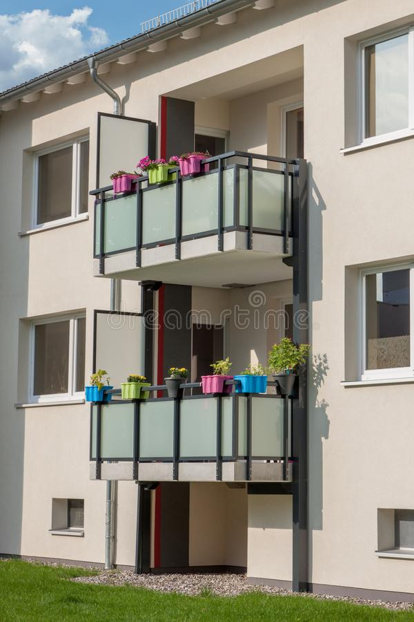 House with balconys and colorful planters stock photo