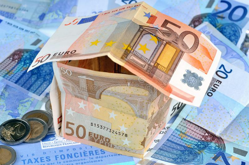 The house in bank notes on a French form of property taxes stock photos