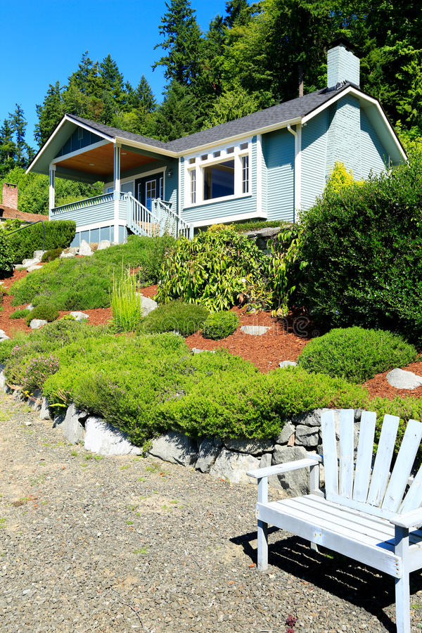 House with beautiful curb appeal and outdoor rest area. Port Orc. House with beautiful front yard landscape. and outdoor rest area with chair. Port Orchard town royalty free stock images