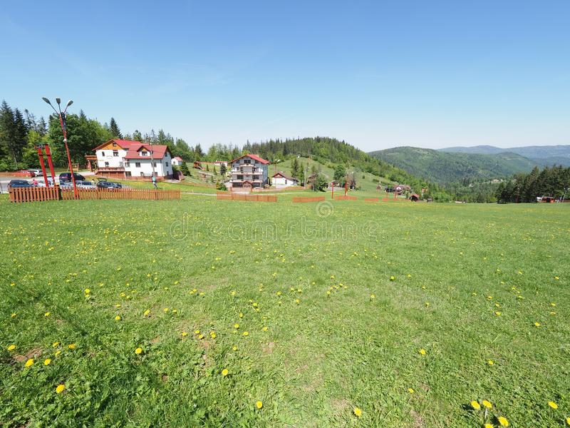 House at beauty green landscape of grassy terrain, forest at Beskid Mountains range at european Salmopol village POLAND. House at beauty green landscapes of stock images