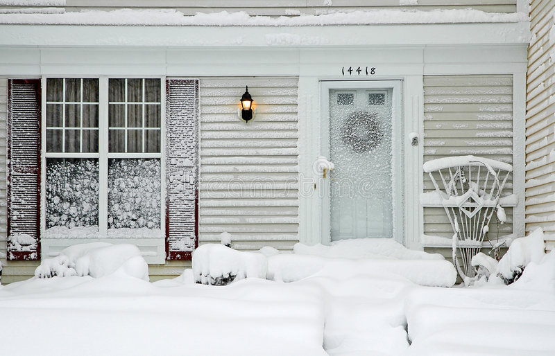 House During Big Snowstorm. Neighbor's house during a big snow storm royalty free stock images