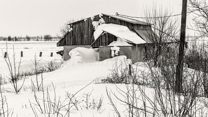 A house after blizzard. A house after two days of blizzard. Photo taken from train stock photography