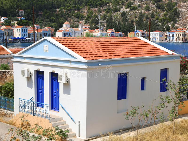 House with Blue Doors and Window Shutters stock image