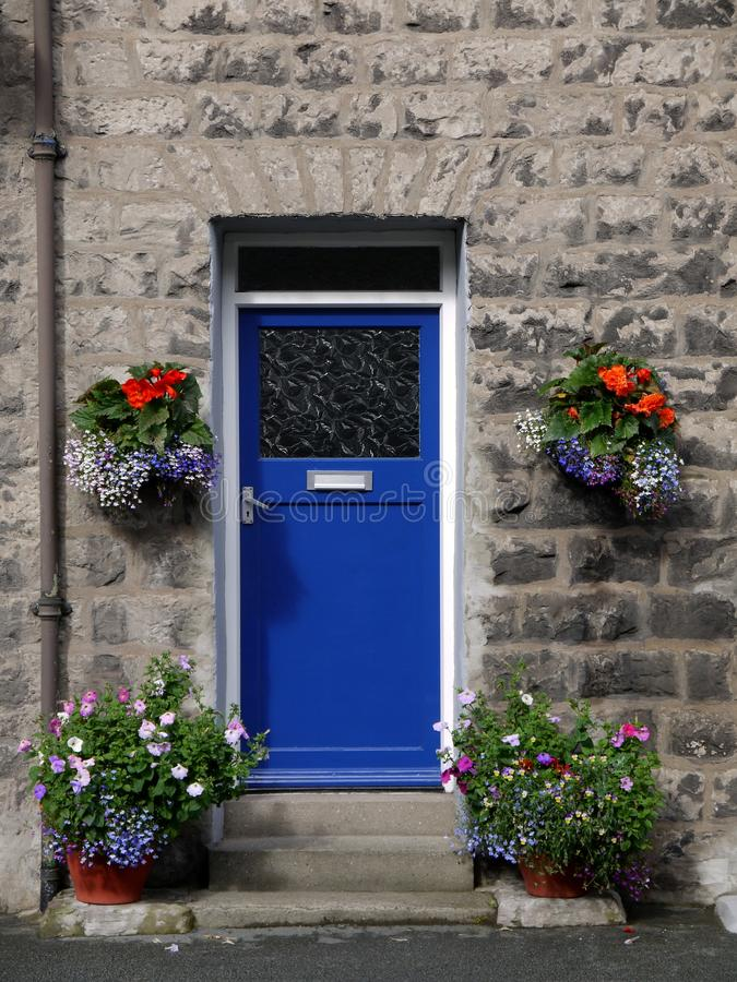 House: Blue Front Door With Flowers Royalty Free Stock Photo