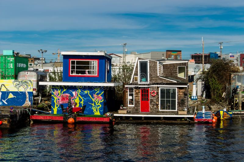 House boats on Lake Union in Seattle. Bright colors and unique styles. each one is different royalty free stock image