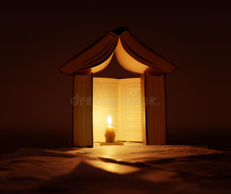 House of books with candle light stock photos