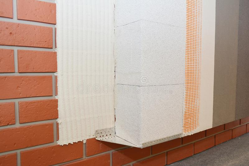 House brick wall renovation, insualtion with glue plastering layers,  reinforcment mesh, aerated concrete blocks, finishing render. Stucco. External wall stock images