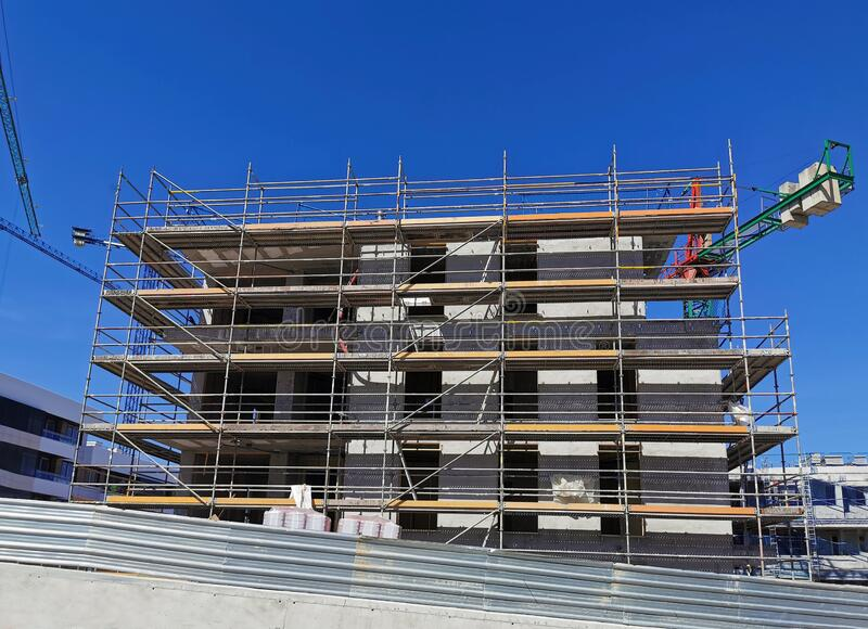 house building construction with scaffolding stock image