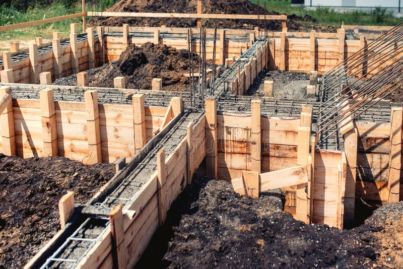 House building construction site, foundation and cement pouring royalty free stock photography