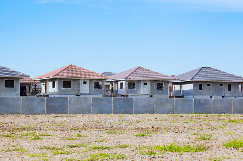 House Building and Construction Site village in progress, waiting for sale concept royalty free stock photos