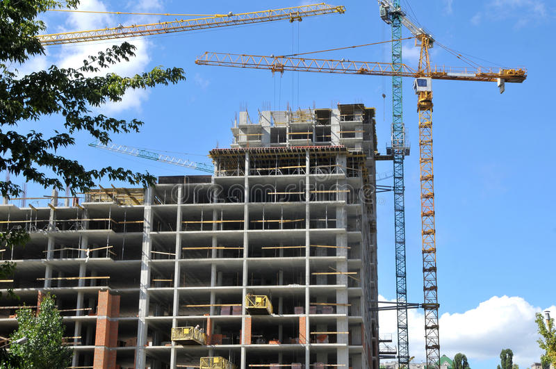 House building and cranes stock photo