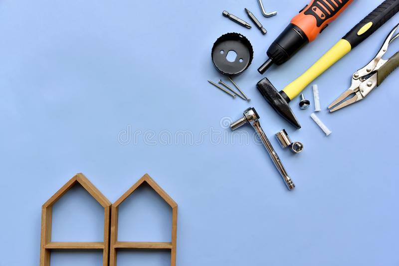 House building and maintenance, DIY and construction. House building and maintenance, DIY and construction tools on blue background stock image