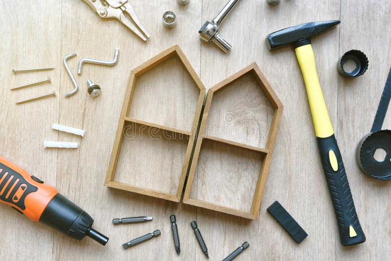 House building and maintenance, DIY and construction tools. House building and maintenance, DIY and construction tools on wooden background royalty free stock photography