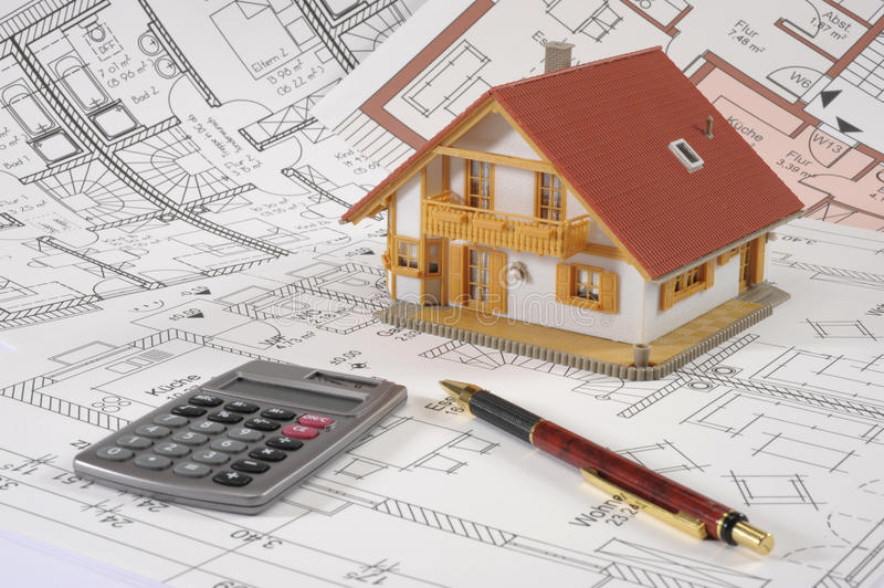 House building plan. An architectonic or construction plan for building a house, symbolic with hand calculator and pencil stock images