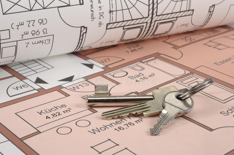 House building plan. An architectonic or construction plan for building a house, symbolic with keys stock photography