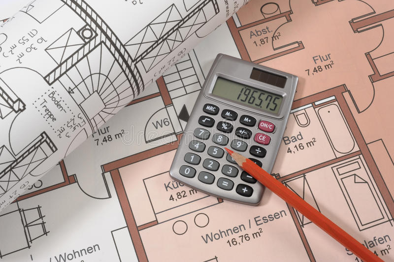House building plan. An architectonic or construction plan for building a house, symbolic with hand calculator and pencil royalty free stock photo