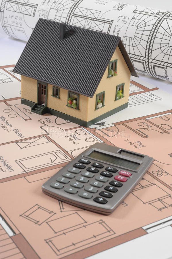 House building plan. An architectonic or construction plan for building a house, symbolic with hand calculator stock image