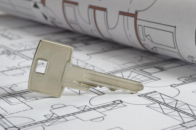 House building plan. An architectonic or construction plan for building a house, symbolic with key royalty free stock photo