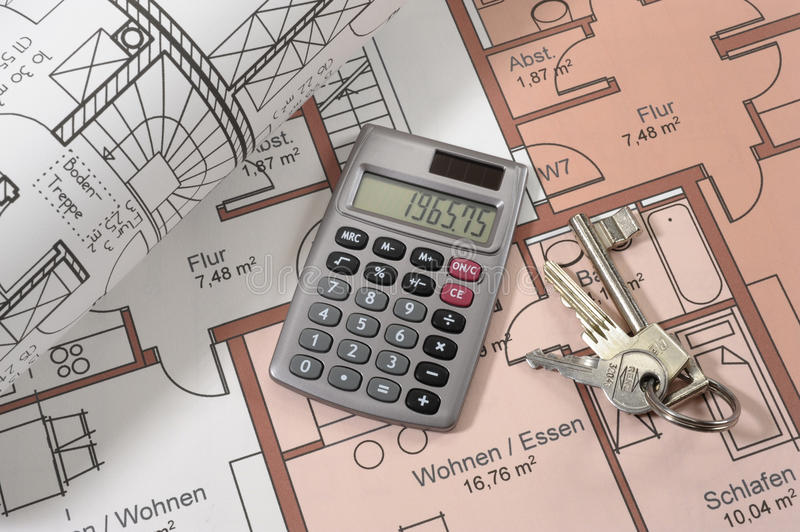 House building plan. An architectonic or construction plan for building a house, symbolic with hand calculator and keys royalty free stock photography
