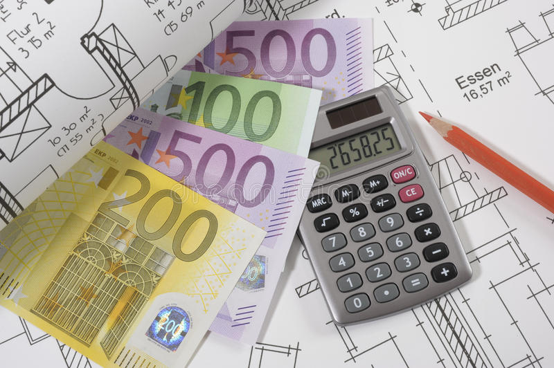 House building plan. An architectonic or construction plan for building a house, symbolic with hand calculator and money euros royalty free stock images