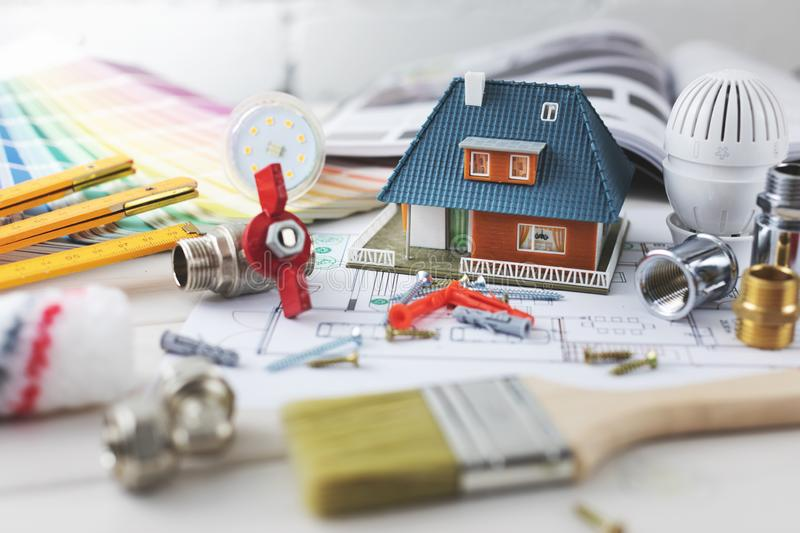House building and repair concept - construction and design items. On housing plan stock photos