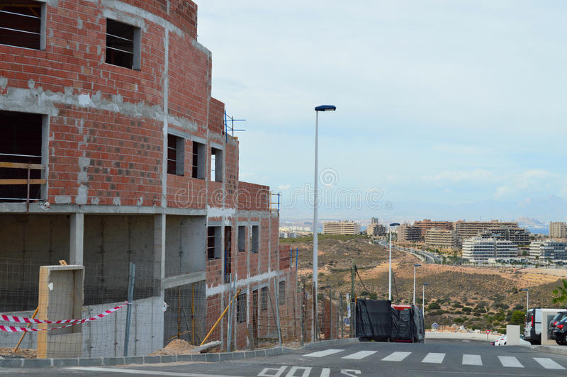 Construction Spain - Building Site House Development. The house building is again going at a rapid pace along Spains Costa Blanca coastline in Gran Alacant with royalty free stock images