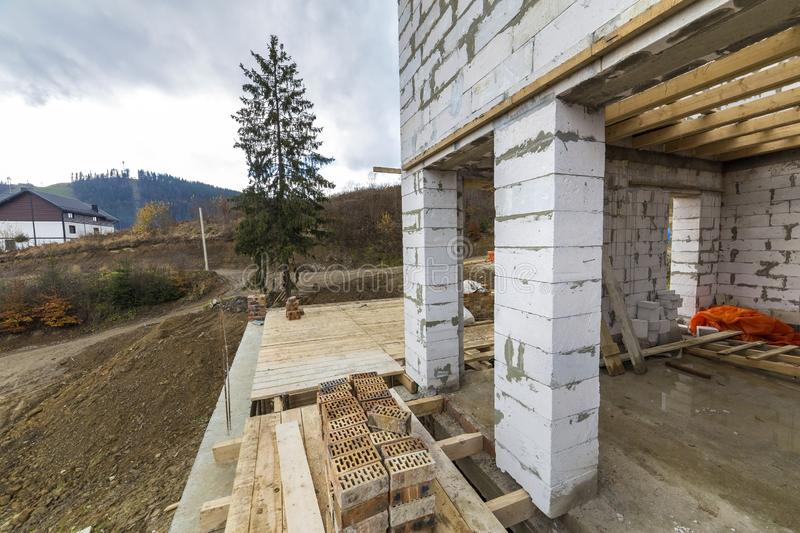 House building under construction basement detail with walls made of large hollow foam insulation blocks, wooden logs frame for stock images