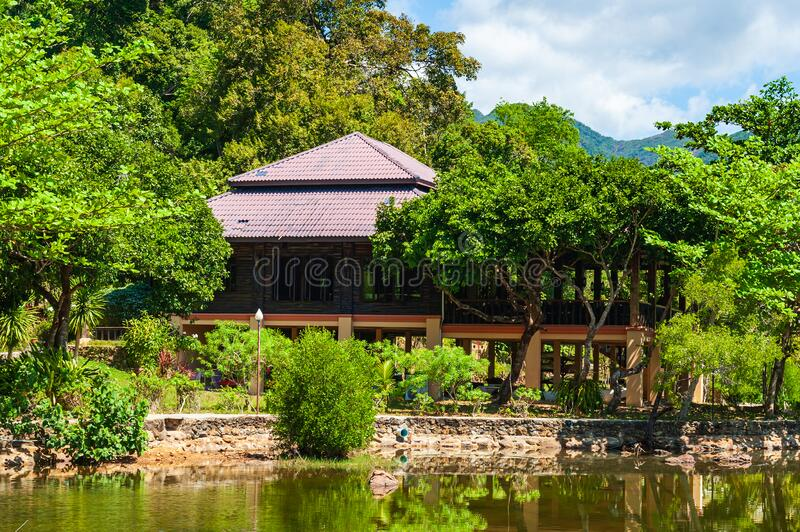 House built on stilts in the lush green tropical forest. royalty free stock photography