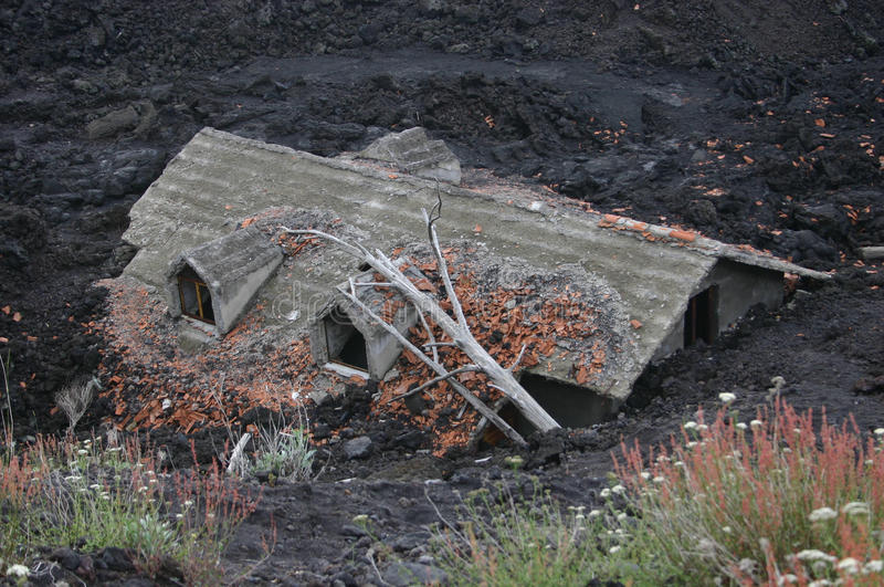 House buried by lava royalty free stock photo