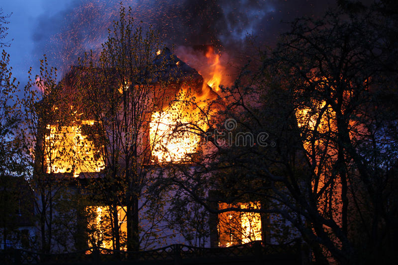 House burning down stock images