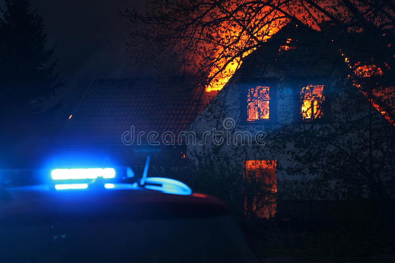 House in burning flames stock image