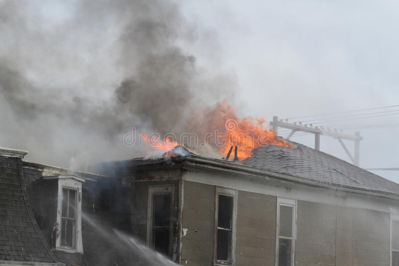 Roof top of house burning royalty free stock photo