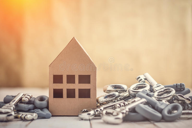 House business concept. Concept image for new home with shiny house keys on a white wooden background. Copy space.house business concept stock image