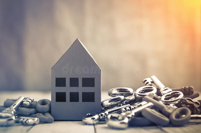 House business concept. Concept image for new home with shiny house keys on a white wooden background. Copy space.house business concept stock photo