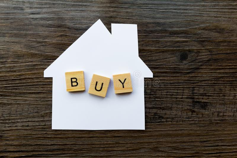 House Purchase Concept - The word `buy` on a paper house. House Buying Concept - Paper house with the word `Buy` on top stock images