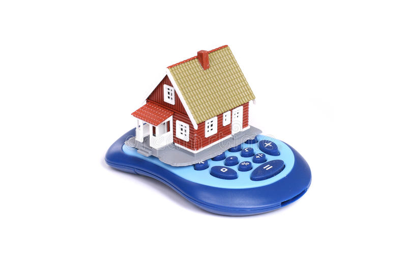 House And Calculator Over White Background. Royalty Free Stock Image