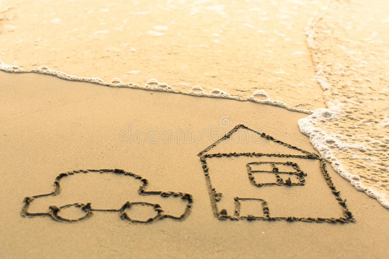 House and a Car drawing on the beach sand. With the soft wave royalty free stock images