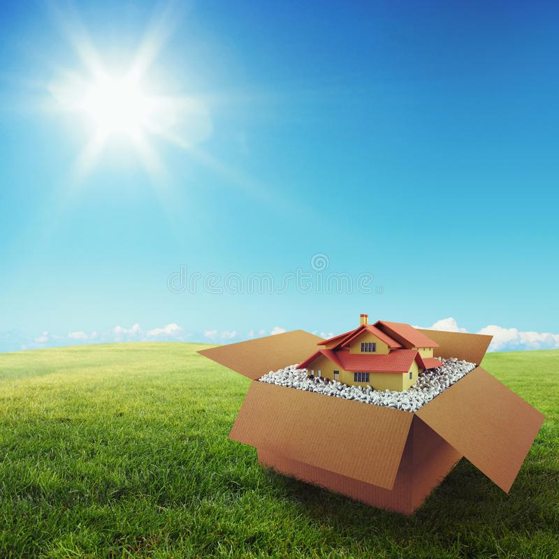 House in a cardboard box. Concept of buying a dwelling. 3D Rendering. House in a cardboard box on a green field under the blue sky. 3D Rendering stock illustration