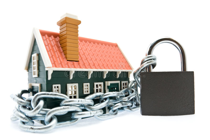 House in chains locked with padlock royalty free stock image